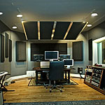 Photo of a recording studio control room with acoustic panels installed.