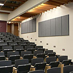 Photo of a university lecture hall with acoustic panels installed.