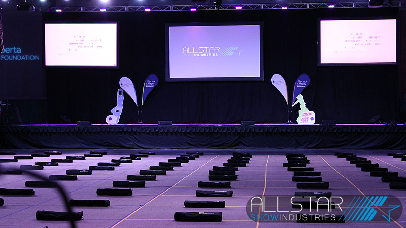 The stage and projection screens set-up for Bust a Move at the Edmonton Expo Centre.