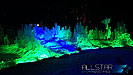 The snow and ice wall lit up for the University of Alberta's Green & Glow Winterfest