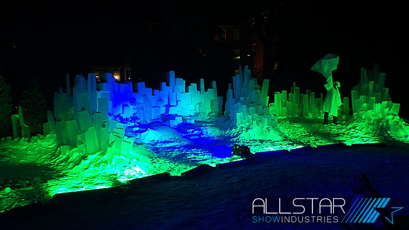 Lighting the snow and ice wall at the University of Alberta Alumni Association's 100th anniversary Green & Glow Winterfest