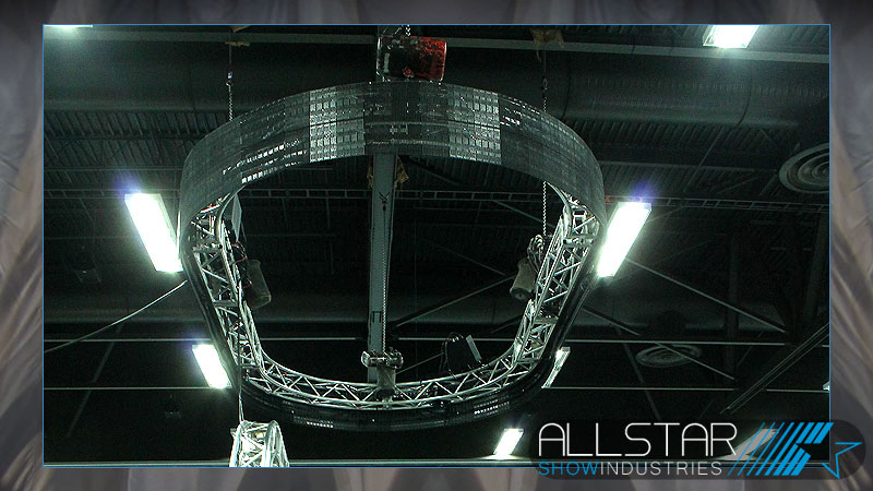 Allstar's Flex LED panels on an oval truss above Martin Motor Sports trade show booth.