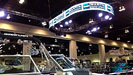 Allstar's Flex LED panels on an oval truss displaying client supplied content above Martin Motor Sports trade show booth.
