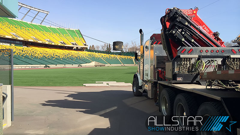 Cherry picker entering Commonwealth Stadium to help remove the top and components of the old speaker pod.