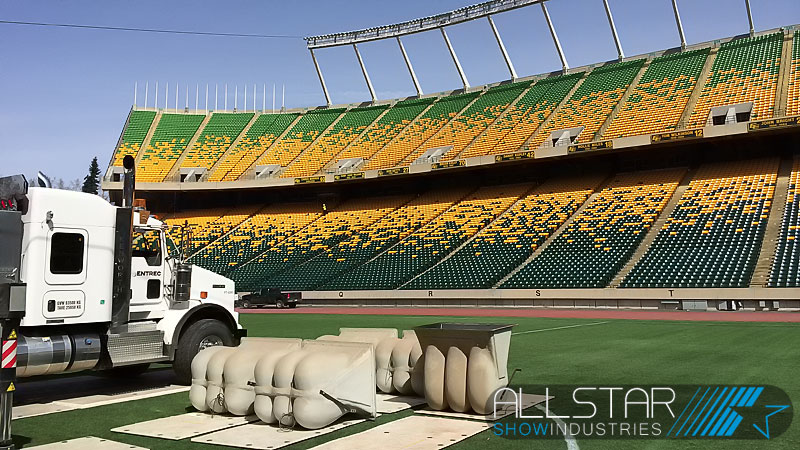 Loading the new centre speaker pod with Community loudspeakers at Edmonton's Commonwealth Stadium.