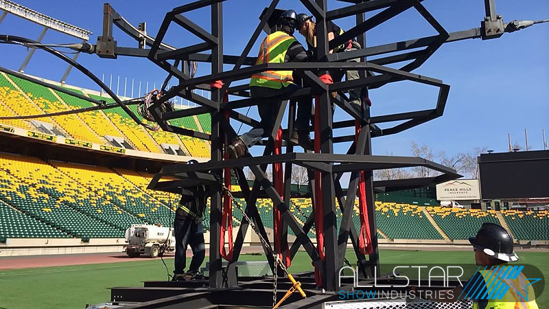 Installers at Edmonton's Commonwealth Stadium prepairing the new speaker pod.
