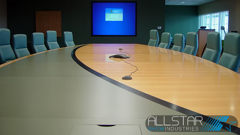 Looking down the table toward the rear projection screen in the executive boardroom at the Edmonton International Airport