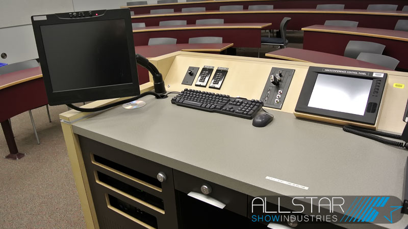 Typical classroom furnature with audiovisual control system supplied and installed by Allstar Show Industries at MacEwan University.