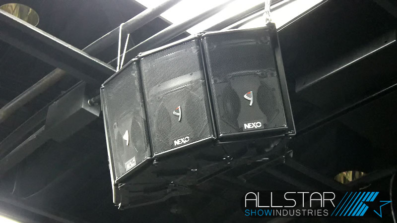 NEXO speakers are hung in left / right horizontal arrays with cardioid subs to divert low frequencies from the stage.