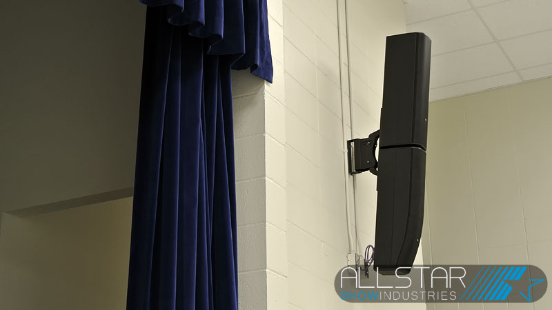 JBL CBT 70J-1 with CBT 70JE-1 extention are wall mounted one on either side of the stage