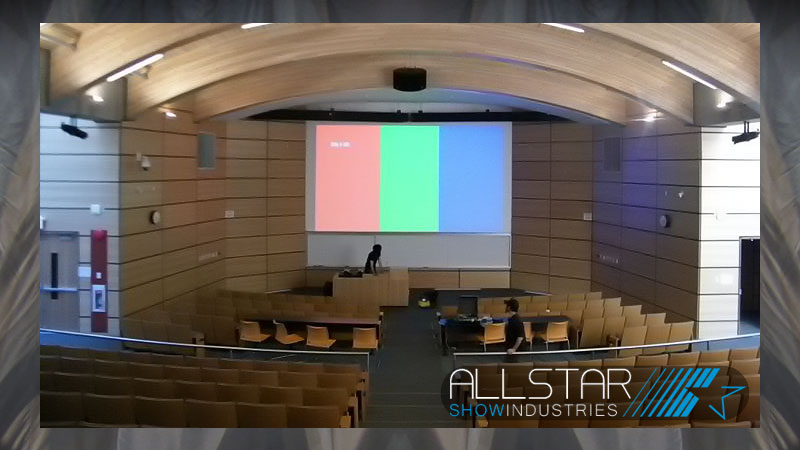 A single 16:9 projection screen in UBC's Centre for Interactive Research on Sustainability Lecture Theatre