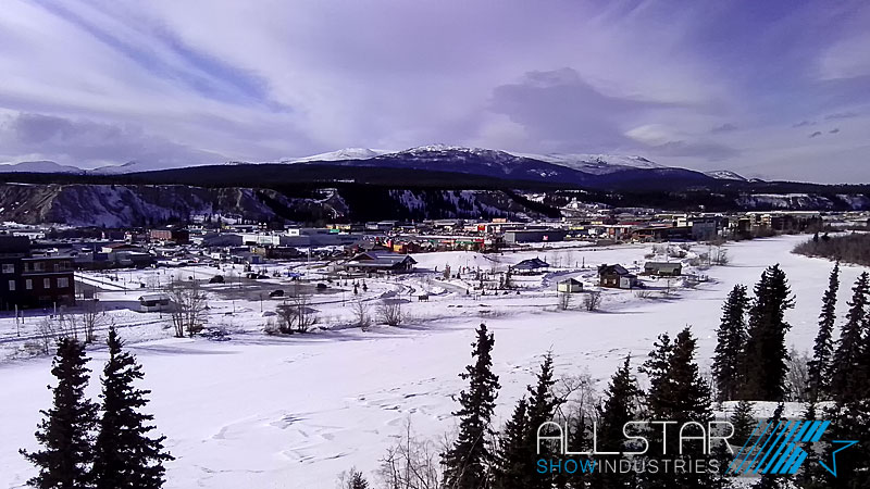 Whitehorse Yukon with a big sky and snow on the ground.
