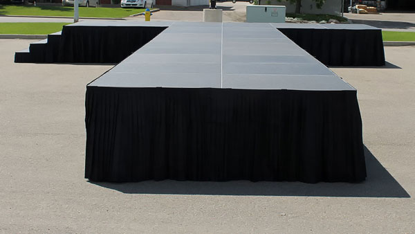 An XL Stage runway set up in a parking lot