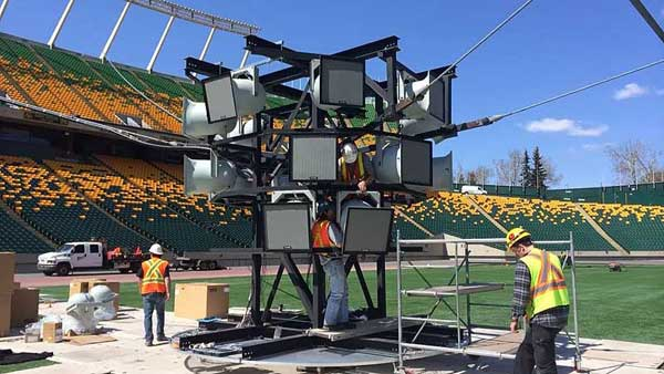 Allstar Show Industry installers loading the centre speaker cluster frame for Edmonton's Commonwealth Stadium Audio System Upgrade