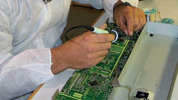 Allstar Show Industries Electronic Bench Technician at work repairing equipment