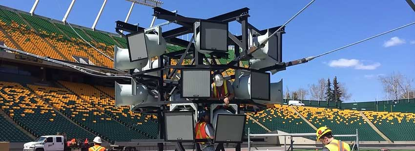 Allstar technicians installing Community speakers in Edmonton's Commonwealth Stadium new centre speaker pod.